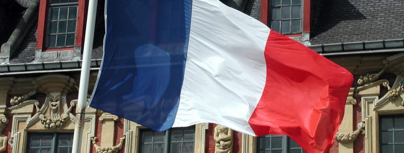 The French flag flying in front of a town hall