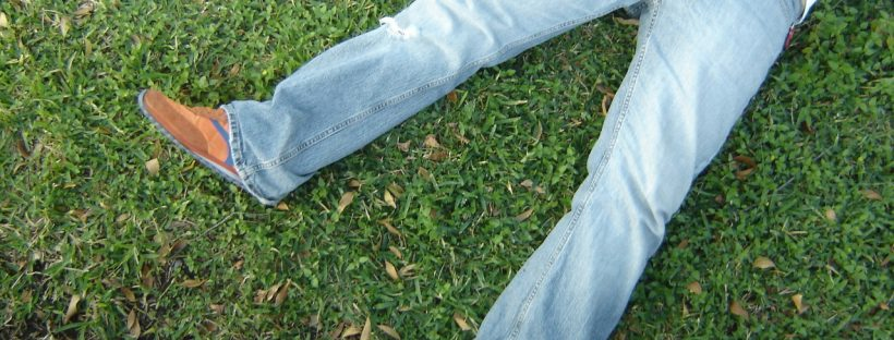 A man lying on the grass - a great anxiety buster!
