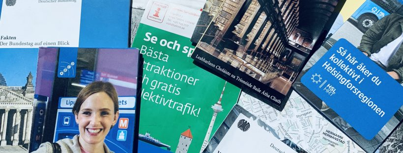 A stash of tourist leaflets and guides in various foreign languages.
