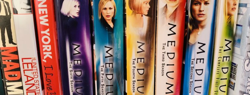 Boxsets of DVDs on a shelf